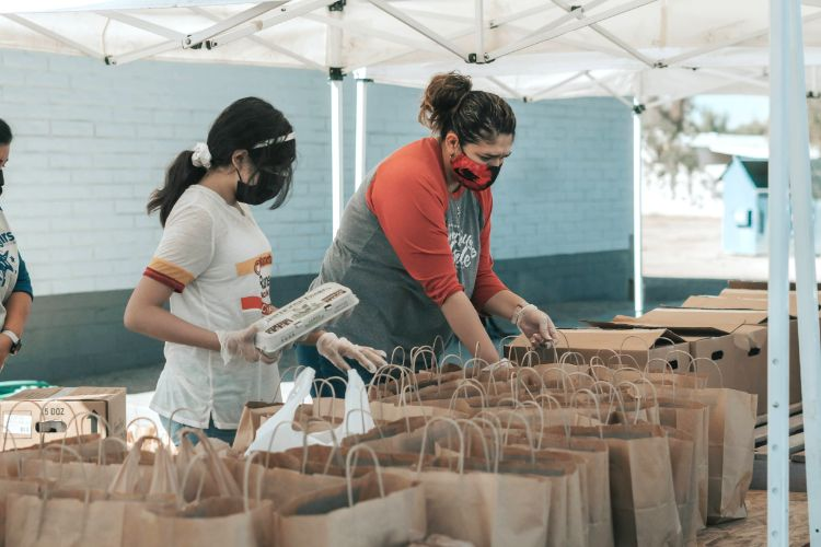 Creating care packages as part of a workplace volunteering program