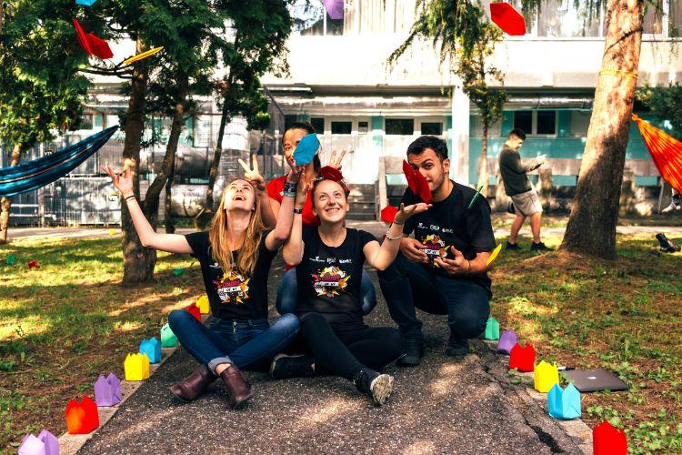 Team celebrating corporate volunteering success at the park