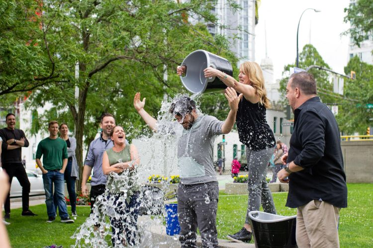 Employees participating in ice bucket challenge as part of workplace giving program.